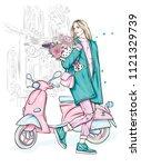 beautiful girl in a stylish...   Shutterstock .eps vector #1121329739