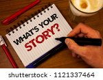 Small photo of Word writing text What'S Your Story Question. Business concept for Connect Communicate Connectivity Connection Hand grasp black marker wooden desk red pen notepad expos texts coffee.