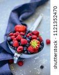organic fresh harvested berries.... | Shutterstock . vector #1121352470