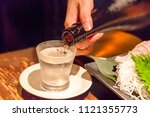 pour a cold sake well alcohol... | Shutterstock . vector #1121355773