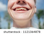 young girl smiles and shows... | Shutterstock . vector #1121364878