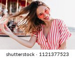 carefree caucasian lady playing ... | Shutterstock . vector #1121377523