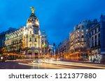 car and traffic lights on gran... | Shutterstock . vector #1121377880
