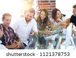 smiling team discussing the... | Shutterstock . vector #1121378753