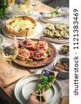 dinner table with snacks... | Shutterstock . vector #1121383469