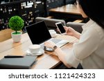 close up the hand of an asian... | Shutterstock . vector #1121424323
