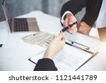 businessman giving pen to... | Shutterstock . vector #1121441789