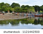docking fishing boats in inland ... | Shutterstock . vector #1121442503