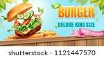 deluxe king size burger ads...   Shutterstock .eps vector #1121447570