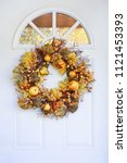 autumn wreath hanging on a... | Shutterstock . vector #1121453393