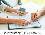 women real estate agent showing ... | Shutterstock . vector #1121455280