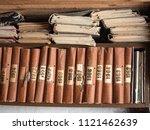 old books on wooden bookshelf.... | Shutterstock . vector #1121462639