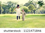 muslim brother and sister... | Shutterstock . vector #1121471846