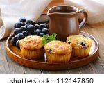 homemade fruit cupcakes on the wooden plate - stock photo