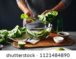 man is preparing green salad of ... | Shutterstock . vector #1121484890