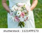 wedding bouquet of flowers held ... | Shutterstock . vector #1121499173