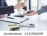 salesman send key to customer... | Shutterstock . vector #1121506349
