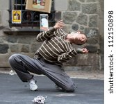 Small photo of AURILLAC, FRANCE - AUGUST 24: a man dances in the street as part of the Aurillac International Street Theater Festival,show by the Company Idem,on august 24, 2012, in Aurillac,France.