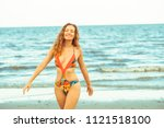 happy young woman wearing... | Shutterstock . vector #1121518100