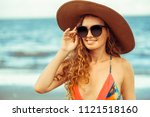 happy young woman wearing... | Shutterstock . vector #1121518160
