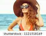 happy young woman wearing... | Shutterstock . vector #1121518169