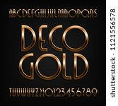 golden art deco alphabet font.... | Shutterstock .eps vector #1121556578
