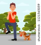 small angry dog barking at man. ... | Shutterstock .eps vector #1121565059