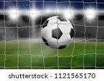 soccer lands in the goal  in... | Shutterstock . vector #1121565170