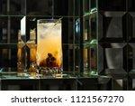 lemonade cocktail on a mirror... | Shutterstock . vector #1121567270