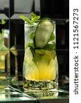 lemonade cocktail on a mirror... | Shutterstock . vector #1121567273