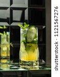 lemonade cocktail on a mirror... | Shutterstock . vector #1121567276
