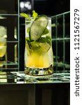 lemonade cocktail on a mirror... | Shutterstock . vector #1121567279
