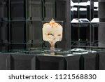 dessert tiramisu in a glass in... | Shutterstock . vector #1121568830