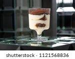 dessert tiramisu in a glass in... | Shutterstock . vector #1121568836