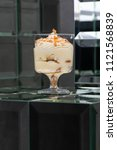 dessert tiramisu in a glass in... | Shutterstock . vector #1121568839
