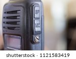 close up of black police radio... | Shutterstock . vector #1121583419