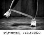 woman exercising with rubber... | Shutterstock . vector #1121596520