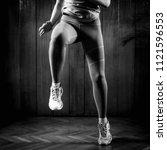 woman doing high knees on high...   Shutterstock . vector #1121596553