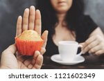 ugar addiction, healthy lifestyle, weight loss, dietary, healthcare and medical concept. Cropped portrait of overweight woman refusing muffin