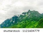 doi luang chiang dao with rain...   Shutterstock . vector #1121604779