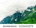 doi luang chiang dao with rain... | Shutterstock . vector #1121612273