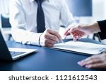 businessman hand signing... | Shutterstock . vector #1121612543