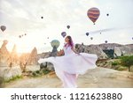 woman in a long dress on... | Shutterstock . vector #1121623880