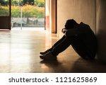 emotional moment  man sitting... | Shutterstock . vector #1121625869