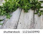 green fresh mint om the wooden... | Shutterstock . vector #1121633990
