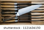 steel kitchen knife with a... | Shutterstock . vector #1121636150