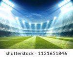 lights at night and football... | Shutterstock . vector #1121651846