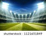 lights at night and football... | Shutterstock . vector #1121651849