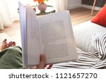 young woman reading book on... | Shutterstock . vector #1121657270