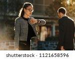 woman looking at her wrist... | Shutterstock . vector #1121658596